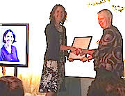 photo of Chelsea Specht receiving an award